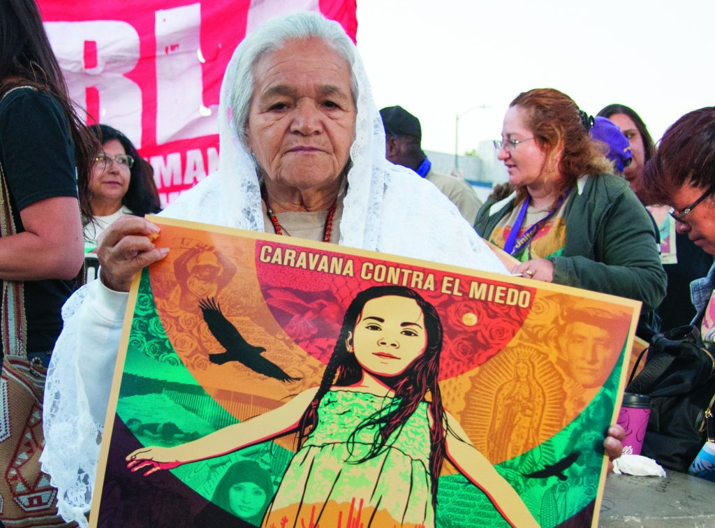 Members of CHIRLA and other immigrant rights coalitions gather at the break of dawn on Wilshire Boulevard and Alvarado Street to demand dignity and respect as part of the Caravana Contra el Miedo.