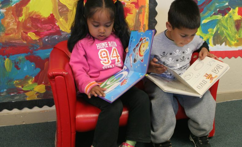 Transforming America's Primary Education System, student reading to teacher