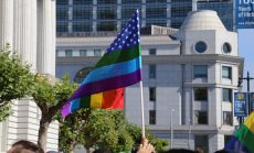 Gay pride flag waves by San Francisco City Hall after SCOTUS announcement