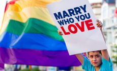 "Boy with ""Marry Who You Love"" sign"