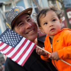 Dad and daughter hold an American flag at a march