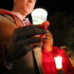 Man holding candle at World Aids Day