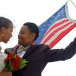 Lesbian couple with american flag on wedding day