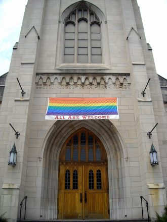 "Church with ""All Are Welcome"" sign"
