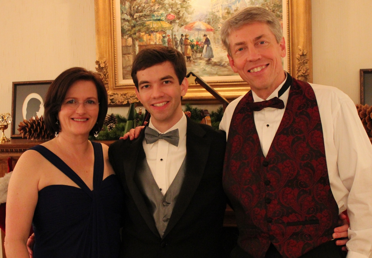 Matthew and his parents at 2011 Christmas party