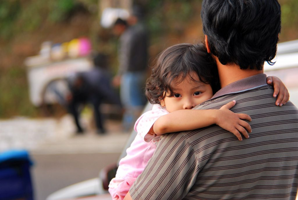 Girl hugging father