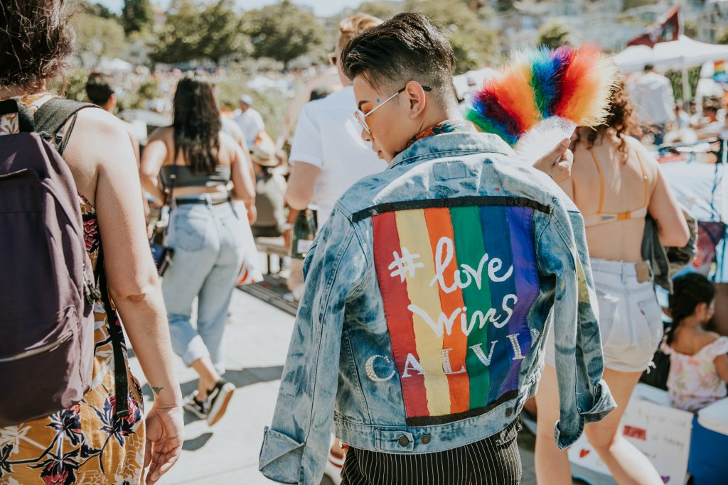 "Photo of person wearing jacket that says ""Love Wins"""
