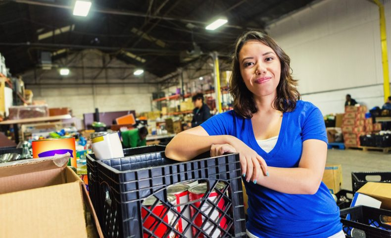 Volunteer working in food bank