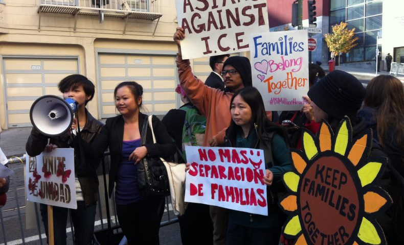 Asian community members march for immigrant rights