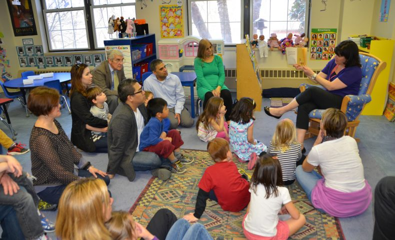 Parents, students, and teachers reading together
