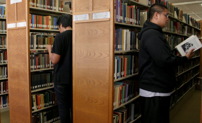 Community college students at the library