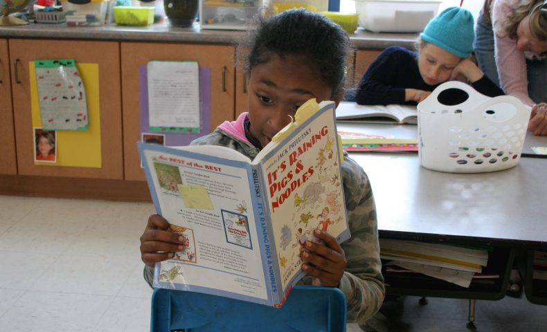 Children reading in a classroom