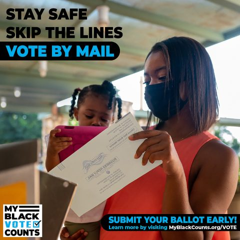 Woman with young child delivering voter ballot