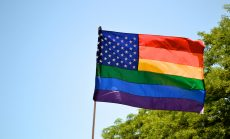 Gay pride and American flag symbolizes LGBT and immigrant rights