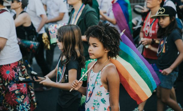Young Girl with Rainbow Flag