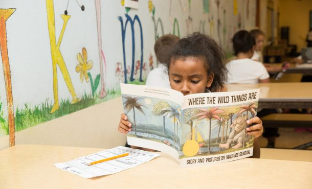 San Francisco Unified student reads at school