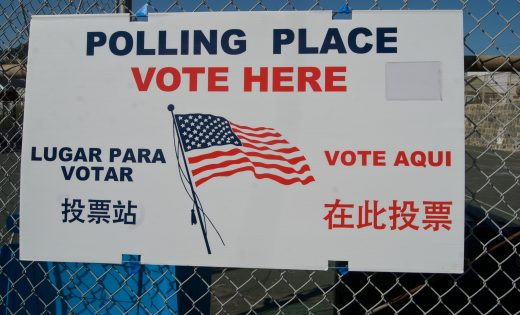 Polling place sign on fence