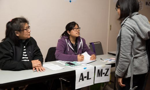 Immigrant support volunteers at naturalization clinic