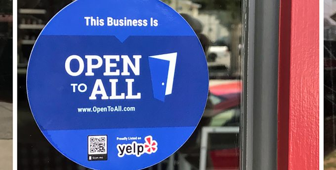 """Open to All"" sign in window"